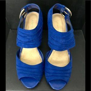 Attention,Cobalt blue sandals.